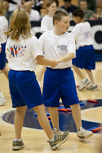 The Taylor Elementary School's 5th Grade Dance Team performs during half-time at the Georgetown Hoyas and Missouri State University Lady Bears women's basketball game. The Hoyas won 72-59, improving to 9-3 on the season. (Image taken by Patrick R. Kane on 19 Dec 2010 with Canon EOS-1D Mark III at ISO 2000, f2.8, 1/400 sec and 140mm)