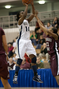 Georgetown's #14 Sugar Rodgers shoots over Missouri State's #23 Jaleshia Roberson. The Hoyas won 72-59, improving to 9-3 on the season. (Image taken by Patrick R. Kane on 19 Dec 2010 with Canon EOS-1D Mark III at ISO 2000, f2.8, 1/400 sec and 170mm)