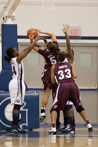 Missouri State's #5 Casey Garrison goes to the board against Georgetown's #14 Sugar Rodgers and #12 Tommacina McBride as Missouri State's #33 Christiana Shorter gets ready for a rebound. The Hoyas won 72-59, improving to 9-3 on the season. (Image taken by Patrick R. Kane on 19 Dec 2010 with Canon EOS-1D Mark III at ISO 2000, f2.8, 1/250 sec and 200mm)
