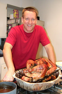 Patrick with a post-Thanksgiving smoked turkey. We decided to mix it up a little and we had a smoked ham on Thanksgiving, followed by a smoked turkey on the Saturday afterwards. These were Patrick's first long cooks on his Big Green Egg and he was pleased with the moist and tasty result. (Image taken by Kathy T. Kane on 27 Nov 2010 with FinePix F10 at ISO 800, f2.8, 1/100 sec and 8mm)
