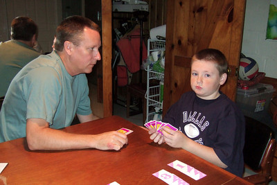 Patrick helping Christopher play Hand 'n Foot with his sister and grandparents (Image taken by Kathy T. Kane on 25 Nov 2010 with FinePix F10 at ISO 800, f2.8, 1/100 sec and 8mm)