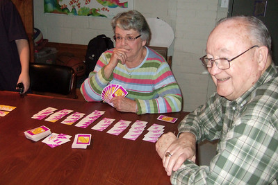 Mary Clare and Grady Kane playing Hand 'n Foot with their grandchildren(Image taken by Kathy T. Kane on 24 Nov 2010 with FinePix F10 at ISO 800, f2.8, 1/100 sec and 8mm)