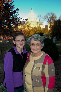 Sydney with her grandmother, Mary Clare, outside the U.S. Botanic Garden with the U.S. Capitol in the background. (Image taken by Patrick R. Kane on 28 Nov 2010 with FinePix F10 at ISO 200, f2.8, 1/419 sec and 8mm)