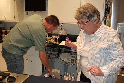 Patrick with his mother, Mary Clare, cleaning up after Thanksgiving dinner (Image taken by Kathy T. Kane on 25 Nov 2010 with FinePix F10 at ISO 800, f2.8, 1/100 sec and 8mm)