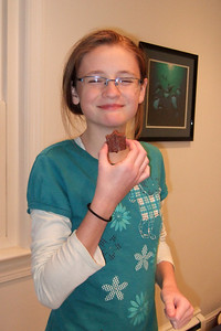 Sydney enjoying the fudge she made with her grandmother (Image taken by Kathy T. Kane on 25 Nov 2010 with FinePix F10 at ISO 800, f2.8, 1/100 sec and 8mm)