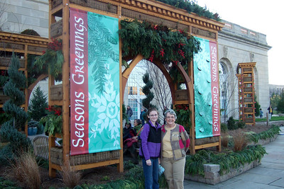 Sydney with her grandmother, Mary Clare, outside the U.S. Botanic Garden. (Image taken by Patrick R. Kane on 28 Nov 2010 with FinePix F10 at ISO 200, f2.8, 1/150 sec and 8mm)