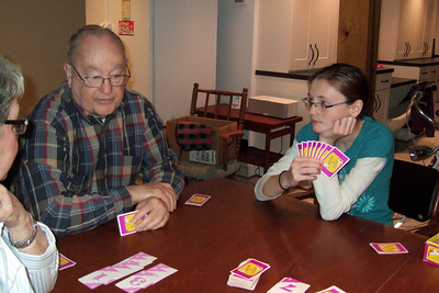 Grady and his granddaughter, Sydney, playing Hand 'n Foot (Image taken by Kathy T. Kane on 25 Nov 2010 with FinePix F10 at ISO 800, f2.8, 1/100 sec and 8mm)
