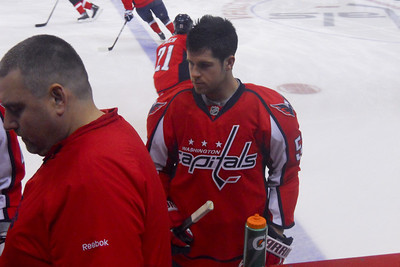 #52 Mike Green during the pre-game warm up. As a Christmas gift, Kathy gave Patrick and Christopher a couple of great tickets (Sec 103, Row J, Seats 9 & 10) to the Washington Capitals vs. Vancouver Canucks game. The boys had a great time even though the Caps didn't win. (Image taken by Patrick R. Kane on 14 Jan 2011 with COOLPIX S570 at ISO 400, f3.7, 1/160 sec and 9.6mm)