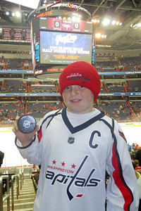 One of the equipment managers handed Christopher a puck after the pre-game warm up. Fresh off the ice, it was wet and cold. As a Christmas gift, Kathy gave Patrick and Christopher a couple of great tickets (Sec 103, Row J, Seats 9 & 10) to the Washington Capitals vs. Vancouver Canucks game. The boys had a great time even though the Caps didn't win. (Image taken by Patrick R. Kane on 14 Jan 2011 with COOLPIX S570 at ISO 400, f2.7, 1/60 sec and 5mm)