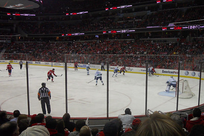 1st period action in the Verizon Center. As a Christmas gift, Kathy gave Patrick and Christopher a couple of great tickets (Sec 103, Row J, Seats 9 & 10) to the Washington Capitals vs. Vancouver Canucks game. The boys had a great time even though the Caps didn't win. (Image taken by Patrick R. Kane on 14 Jan 2011 with COOLPIX S570 at ISO 250, f2.7, 1/250 sec and 5mm)
