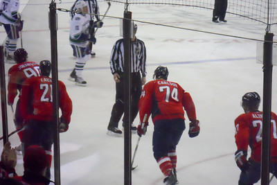 #90 Marcus Johansson scores at 09:21 in the 3rd to pull within one of the Canucks. As a Christmas gift, Kathy gave Patrick and Christopher a couple of great tickets (Sec 103, Row J, Seats 9 & 10) to the Washington Capitals vs. Vancouver Canucks game. The boys had a great time even though the Caps didn't win. (Image taken by Patrick R. Kane on 14 Jan 2011 with COOLPIX S570 at ISO 800, f6.6, 1/160 sec and 25mm)
