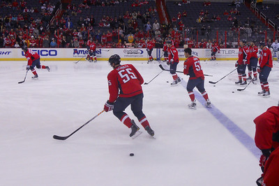 Caps pre-game warm up. As a Christmas gift, Kathy gave Patrick and Christopher a couple of great tickets (Sec 103, Row J, Seats 9 & 10) to the Washington Capitals vs. Vancouver Canucks game. The boys had a great time even though the Caps didn't win. (Image taken by Patrick R. Kane on 14 Jan 2011 with COOLPIX S570 at ISO 250, f2.7, 1/250 sec and 5mm)
