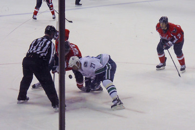 #90 Marcus Johansson faces off against #27 Manny Malhotra of the Canucks. As a Christmas gift, Kathy gave Patrick and Christopher a couple of great tickets (Sec 103, Row J, Seats 9 & 10) to the Washington Capitals vs. Vancouver Canucks game. The boys had a great time even though the Caps didn't win. (Image taken by Patrick R. Kane on 14 Jan 2011 with COOLPIX S570 at ISO 400, f5.9, 1/125 sec and 20.3mm)