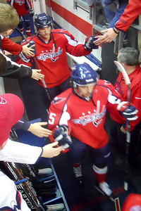 #85 Mathieu Perreault and another Cap coming out of the locker room for the pre-game warm up. As a Christmas gift, Kathy gave Patrick and Christopher a couple of great tickets (Sec 103, Row J, Seats 9 & 10) to the Washington Capitals vs. Vancouver Canucks game. The boys had a great time even though the Caps didn't win. (Image taken by Patrick R. Kane on 14 Jan 2011 with COOLPIX S570 at ISO 800, f2.7, 1/60 sec and 5mm)