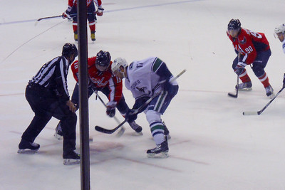 #19 Nicklas Backstrom faces off against #17 Ryan Kesler of the Canucks in the 3rd. As a Christmas gift, Kathy gave Patrick and Christopher a couple of great tickets (Sec 103, Row J, Seats 9 & 10) to the Washington Capitals vs. Vancouver Canucks game. The boys had a great time even though the Caps didn't win. (Image taken by Patrick R. Kane on 14 Jan 2011 with COOLPIX S570 at ISO 400, f5.9, 1/125 sec and 20.3mm)
