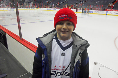 Christopher next to the ice before the pre-game warm up. As a Christmas gift, Kathy gave Patrick and Christopher a couple of great tickets (Sec 103, Row J, Seats 9 & 10) to the Washington Capitals vs. Vancouver Canucks game. The boys had a great time even though the Caps didn't win. (Image taken by Patrick R. Kane on 14 Jan 2011 with COOLPIX S570 at ISO 400, f2.7, 1/200 sec and 5mm)