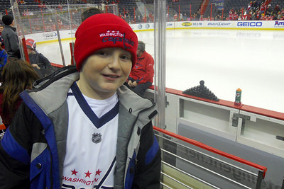 Christopher next to the Capital's bench before the pre-game warm up. As a Christmas gift, Kathy gave Patrick and Christopher a couple of great tickets (Sec 103, Row J, Seats 9 & 10) to the Washington Capitals vs. Vancouver Canucks game. The boys had a great time even though the Caps didn't win. (Image taken by Patrick R. Kane on 14 Jan 2011 with COOLPIX S570 at ISO 400, f2.7, 1/125 sec and 5mm)