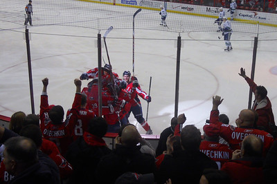 The Caps are celebrating the game's first goal after #26 Matt Hendricks beat Vancouver's Roberto Luongo to stake Washington to a 1-0 lead at 5:50 of the first. As a Christmas gift, Kathy gave Patrick and Christopher a couple of great tickets (Sec 103, Row J, Seats 9 & 10) to the Washington Capitals vs. Vancouver Canucks game. The boys had a great time even though the Caps didn't win. (Image taken by Patrick R. Kane on 14 Jan 2011 with COOLPIX S570 at ISO 80, f2.7, 1/80 sec and 5mm)