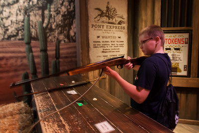 Christopher trying the shooting range at the National Museum of Crime & Punishment (Image taken by Patrick R. Kane on 24 Sep 2011 with Canon EOS-1D Mark III at ISO 1600, f2.8, 1/10 sec and 16mm)