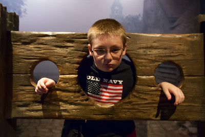 Christopher in a pillory at the National Museum of Crime & Punishment (Image taken by Patrick R. Kane on 24 Sep 2011 with Canon EOS-1D Mark III at ISO 1600, f2.8, 1/25 sec and 16mm)