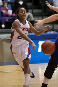 #21 Alexis Dobbs of the American University women's basketball team playing against the Holy Cross Crusaders. The Eagles beat the Crusaders 84 to 53. (Image taken by Patrick R. Kane on 22 Jan 2011 with Canon EOS-1D Mark III at ISO 1600, f2.8, 1/320 sec and 165mm)
