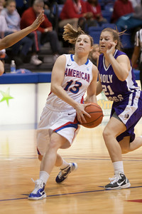 #13 Ashley Yencho of the American University women's basketball team playing against the Holy Cross Crusaders. The Eagles beat the Crusaders 84 to 53. (Image taken by Patrick R. Kane on 22 Jan 2011 with Canon EOS-1D Mark III at ISO 1600, f2.8, 1/320 sec and 145mm)