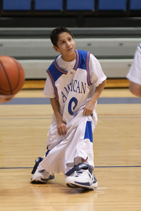 Nick is buried in the over-sized jersey, shorts and shoes that he had to put on in a competition during a time-out in the American University and Holy Cross women's basketball game. Christopher and Nick had to go from one end of the court to the other, getting dressed along the way in extra large shorts, a jersey and shoes, then finish with a layup. (Image taken by Patrick R. Kane on 22 Jan 2011 with Canon EOS-1D Mark III at ISO 1600, f2.8, 1/320 sec and 125mm)