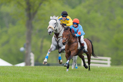 Jordan (1), a large pony ridden by Erin Swope, is ahead of Junior Field Masters Chase winner, Questioning (4), ridden by Zoe Valvo. The 86th running of the Virginia Gold Cup steeplechase race at Great Meadow in The Plains, Virginia (Image taken by Patrick R. Kane on 07 May 2011 with Canon EOS-1D Mark III at ISO 100, f3.5, 1/500 sec and 400mm)