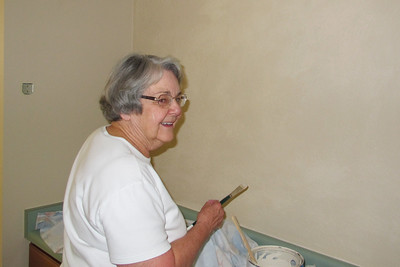 Mary Clare painting the wall after Patrick and Grady removed the mirror and re-textured the wall. (Image taken by Patrick R. Kane on 07 Nov 2012 with Canon PowerShot G12 at ISO 0, f2.8, 1/60 sec and 6.1mm)
