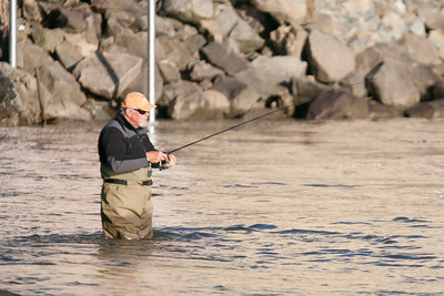 A fisherman at Conowingo Dam trying to catch one of the prevelant fish in this area, e.g., American Shad, American Eel, Tiger Muskellunge, Channel Catfish, Striped Bass, Smallmounth Bass, Largemouth Bass, Walleye, Yellow Perch and Common Carp. (Image taken by Patrick R. Kane on 03 Apr 2012 with Canon EOS-1D Mark III at ISO 640, f4.0, 1/2500 sec and 400mm)
