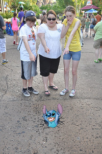 Aunt KK with Christopher and Sydney watching Stitch pop up in the pavement at Disney's Animal Kingdom on 28 May 2012