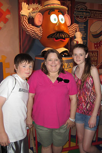 Christopher, Aunt KK and Sydney in front of Mr. Potato Head, Disney's Hollywood Studios (Image taken by Kathy L. Kane on 26 May 2012 with Canon PowerShot ELPH 100 HS at ISO 0, f2.8, 1/60 sec and 5mm)