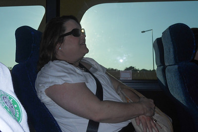 Aunt KK on the bus from the airport to Coronado Springs Resort, Walt Disney World (Image taken by Sydney J. Kane on 25 May 2012 with COOLPIX S570 at ISO 80, f5.6, 1/320 sec and 5.7mm)