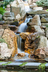 A waterfall in the Japanese-style Garden at Hillwood Estate, Museum & Gardens (Image taken by Patrick R. Kane on 29 Sep 2012 with Canon EOS-1D Mark III at ISO 100, f32.0, 1/3.2 sec and 70mm)