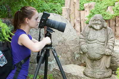 Sydney taking a close-up picture of Hotei, the Japanese god of happiness and prosperity in the Japanese-style Garden at Hillwood Estate, Museum & Gardens (Image taken by Patrick R. Kane on 29 Sep 2012 with Canon EOS-1D Mark III at ISO 200, f8.0, 1/20 sec and 70mm)