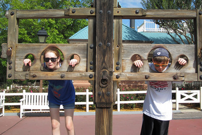 Sydney and Christopher in the Liberty Square pillary at Disney's Magic Kingdom (Image taken by Kathy L. Kane on 27 May 2012 with Canon PowerShot ELPH 100 HS at ISO 0, f3.5, 1/800 sec and 8mm)