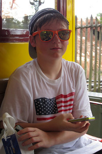 Christopher on the steam train at Disney's Magic Kingdom (Image taken by Kathy L. Kane on 27 May 2012 with Canon PowerShot ELPH 100 HS at ISO 0, f4.0, 1/100 sec and 9.5mm)