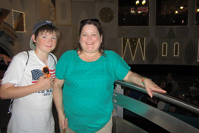 Christopher and Aunt KK enjoying It's a Small World at Disney's Magic Kingdom (Image taken by Kathy L. Kane on 27 May 2012 with Canon PowerShot ELPH 100 HS at ISO 0, f2.8, 1/60 sec and 5mm)