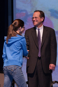 Olivia receiving an award. Each winter, the Arlington Central Library hosts the Regional Scholastic Art Award, a competition which encompasses all Middle School and High School students in Arlington County. Almost 2,000 works of art were submitted and judged by three jurors. Out of these, the judges chose 376 to be awarded either a Gold or a Silver Certificate. The awards ceremony was held at Washington-Lee High School. (Image taken by Kathy T. Kane on 07 Mar 2012 with Canon EOS 20D at ISO 800, f4.0, 1/100 sec and 85mm)