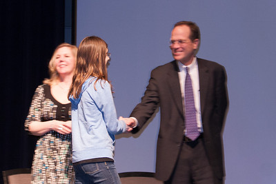 Meredith receiving an award. Each winter, the Arlington Central Library hosts the Regional Scholastic Art Award, a competition which encompasses all Middle School and High School students in Arlington County. Almost 2,000 works of art were submitted and judged by three jurors. Out of these, the judges chose 376 to be awarded either a Gold or a Silver Certificate. The awards ceremony was held at Washington-Lee High School. (Image taken by Kathy T. Kane on 07 Mar 2012 with Canon EOS 20D at ISO 800, f4.0, 1/50 sec and 75mm)