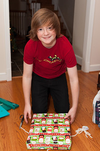Christopher opening his gift from Aunt KK on Christmas Eve 2012 (Image taken by Patrick R. Kane on 24 Dec 2012 with Canon EOS 5D Mark II at ISO 400, f4.0, 1/60 sec and 35mm)