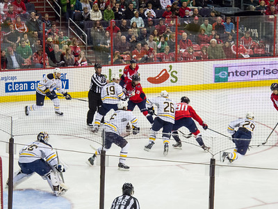 We knew we were in for an exciting game when a faceoff in the Caps' offensive zone resulted in an Ovechkin (at far right) goal 19 seconds into the game. The Washington Capitals defeated the Buffalo Sabres 5-3 in a NHL game on St. Patrick's Day 2013 (Image taken by Patrick R. Kane on 17 Mar 2013 with Canon PowerShot G12 at ISO 0, f4.5, 1/160 sec and 30.5mm)
