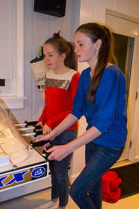 Nora and Sydney playing bubble hockey during Sydney's 15th Birthday Party (11 Jan 2013)