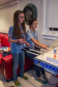 Margaret and Meredith playing bubble hockey during Sydney's 15th Birthday Party (11 Jan 2013)