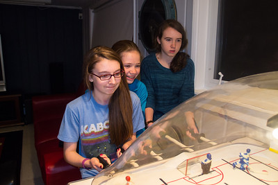 Margaret, Anna and Mary playing bubble hockey during Sydney's 15th Birthday Party (11 Jan 2013)