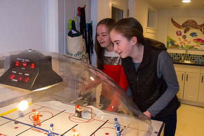 Nora and Addie playing bubble hockey during Sydney's 15th Birthday Party (11 Jan 2013)