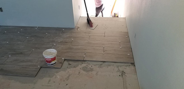Upstairs tile installation. It is the same tile as Andrew's house. 1123 E Cedar St, Rockport, Texas, April 30, 2020