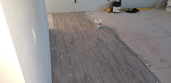 Upstairs tile installation in living room. It is the same tile as Andrew's house. 1123 E Cedar St, Rockport, Texas, April 30, 2020