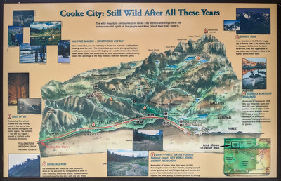 """""""Cooke City: Still Wild After All These Years"""" sign outside the northeast entrance to Yellowstone National Park, Montana"""