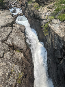 Lake Creek Falls is located in Wyoming, near the Montana border, approximately 1-1/2 miles east of the Beartooth Highway's (US 212) junction with the Chief Joseph Scenic Byway (WY 296).